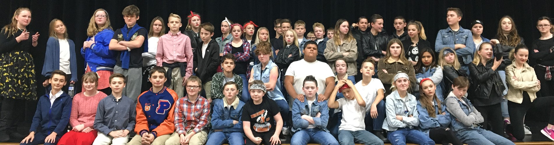 Students dressed as characters from the book, The Outsiders.